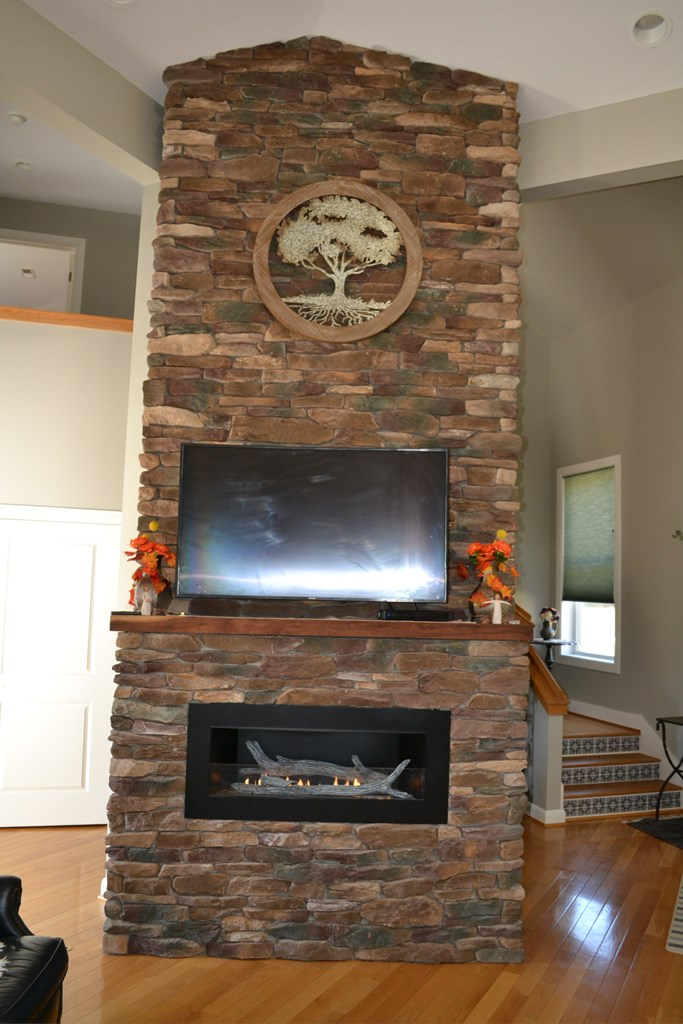 Floor to Ceiling Stone Fireplace (gas)